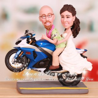 Couple Doing Wheelie Wedding Cake Toppers