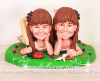 Cute Girls Lying on Grass Cake Toppers