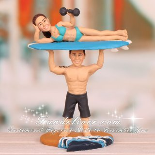 Groom Holding Bride Up on Surfboard Cake Toppers