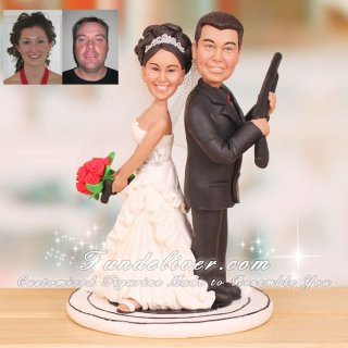 Back to Back Couple Carrying Handgun & Shotgun Cake Toppers