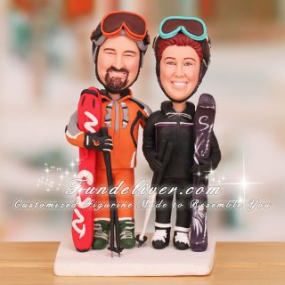 Couple Dressed Up in Ski Jackets and Ski Helmets Cake Toppers