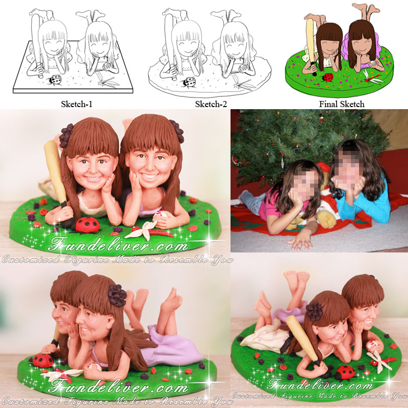 Cute Cake Toppers with Girls Lying on Grass with Shins Crossed and Feet in Air